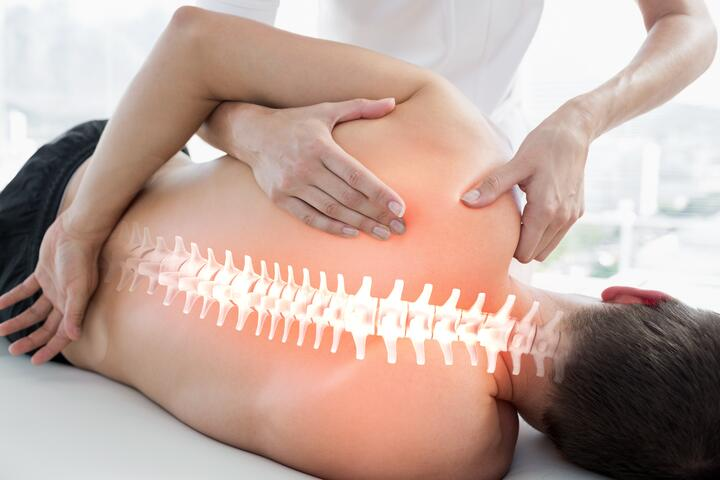 Patient gets rolfing treatment to relieve lumbar back pain.