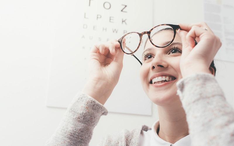 woman-examining-glasses