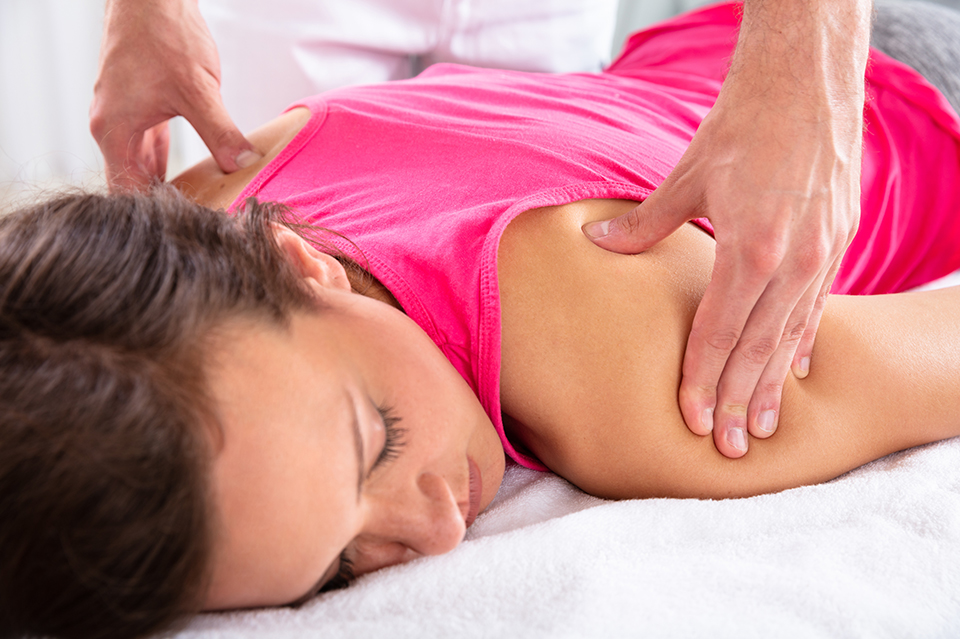 Woman getting massage by doctor