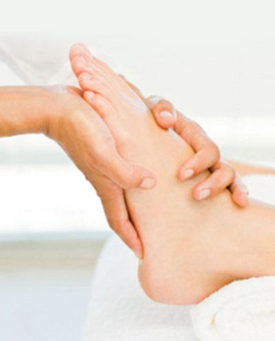 Doctor massaging patient's foot
